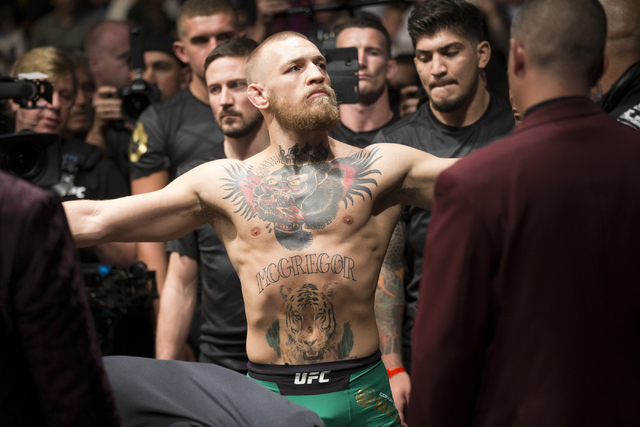 Conor McGregor gets ready to take the octagon for his fight against Nate Diaz in the welterweight bout during UFC 202 at T-Mobile Arena on Saturday, Aug. 20, 2016, in Las Vegas. McGregor won by ma ...