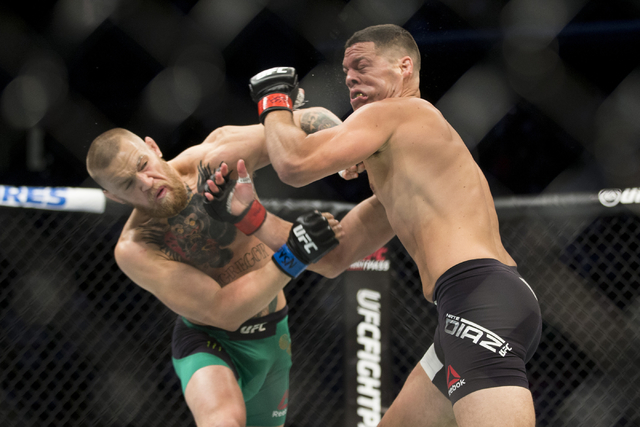 Conor McGregor, left, connects a left punch against Nate Diaz in the welterweight bout during UFC 202 at T-Mobile Arena on Saturday, Aug. 20, 2016, in Las Vegas. McGregor won by majority decision. ...