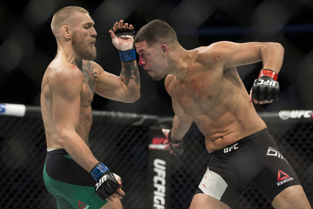 Conor McGregor, left, battles Nate Diaz in the welterweight bout during UFC 202 at T-Mobile Arena on Saturday, Aug. 20, 2016, in Las Vegas. McGregor won by majority decision. (Erik Verduzco/Las Ve ...