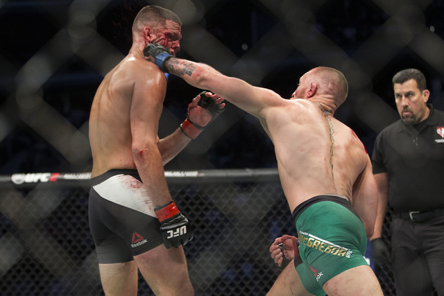 Conor McGregor, right, connects a left punch against Nate Diaz in the welterweight bout during UFC 202 at T-Mobile Arena on Saturday, Aug. 20, 2016, in Las Vegas. McGregor won by majority decision ...