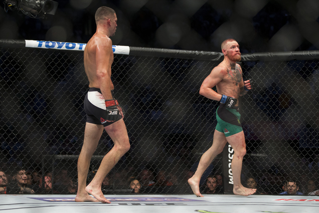 Nate Diaz, left, chases Conor McGregor in the welterweight bout during UFC 202 at T-Mobile Arena on Saturday, Aug. 20, 2016, in Las Vegas. McGregor won by majority decision.  (Erik Verduzco/Las Ve ...