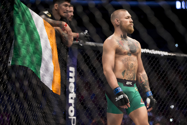 Conor McGregor stands in the octagon ready for his fight against Nate Diaz in the welterweight bout during UFC 202 at T-Mobile Arena on Saturday, Aug. 20, 2016, in Las Vegas. McGregor won by major ...