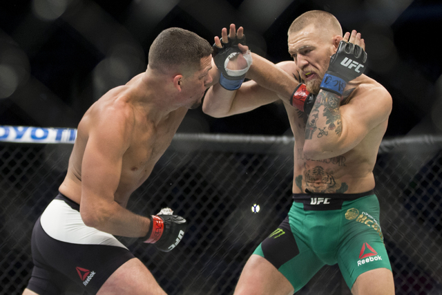 Nate Diaz, left, lands a punch against Conor McGregor in the welterweight bout during UFC 202 at T-Mobile Arena on Saturday, Aug. 20, 2016, in Las Vegas. McGregor won by majority decision. Erik Ve ...