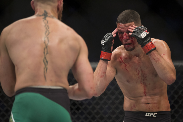 Conor McGregor, left, battles Nate Diaz in the welterweight bout during UFC 202 at T-Mobile Arena on Saturday, Aug. 20, 2016, in Las Vegas. McGregor won by majority decision. Erik Verduzco/Las Veg ...
