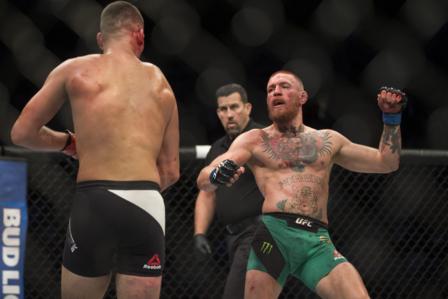 Nate Diaz, left, battles against Conor McGregor in the welterweight bout during UFC 202 at T-Mobile Arena on Saturday, Aug. 20, 2016, in Las Vegas. McGregor won by majority decision. Erik Verduzco ...