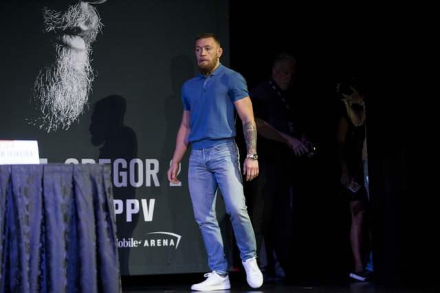 Conor McGregor arrives late to the UFC 202 press conference at the MGM Grand hotel-casino on Wednesday, Aug. 17, 2016, in Las Vegas. Erik Verduzco/Las Vegas Review-Journal Follow @Erik_Verduzco