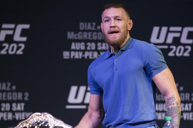 Conor McGregor arrives late to the UFC 202 press conference at the MGM Grand hotel-casino on Wednesday, Aug. 17, 2016, in Las Vegas. Erik Verduzco/Las Vegas Review-Journal Follow @Erik_Verduzco