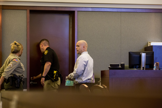 Bayzle Morgan, right, leaves the courtroom after the announcement of the jury's final verdict, which was guilty of robbery, Aug. 12, 2016, in the Regional Justice Center in Las Vegas. Elizabeth Pa ...