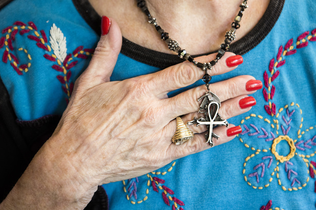 Peggy DiMaria holds an Egyptian ankh cross that her brother, Jay Sebring, gave to her before he was murdered in 1969 by the Charles Manson cult. The ankh stands for the breath of life and symboliz ...