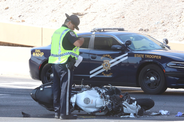 A Nevada Highway Patrol trooper investigates a fatal crash on Interstate 15 near the D Street offramp on Tuesday, Aug. 23, 2016. A motorcyclist is dead after a collision with a Chevrolet Suburban. ...