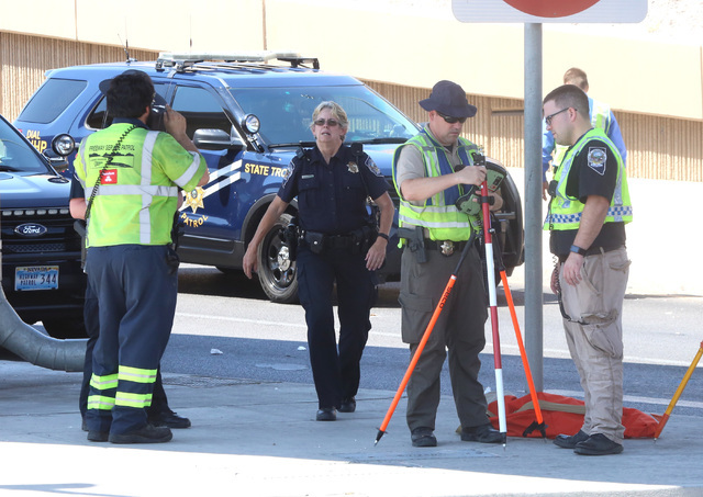 The Nevada Highway Patrol investigates a fatal crash on Interstate 15 near the D Street offramp on Tuesday, Aug. 23, 2016. A motorcyclist is dead after a collision with a Chevrolet Suburban. (Bizu ...