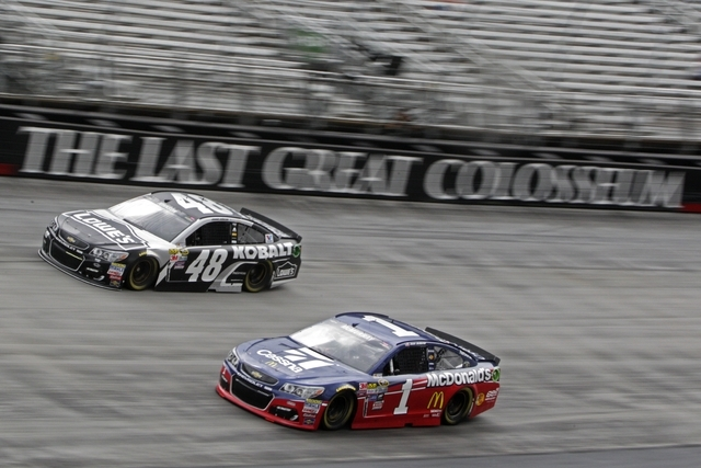 Driver Jamie McMurray (1) and Jimmie Johnson (48) during practice for a NASCAR Sprint Cup auto race, Saturday, Aug. 19, 2016, in Bristol, Tenn. (AP Photo/Wade Payne)