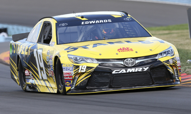 Carl Edwards (19) drives during qualifying for Sunday's NASCAR Sprint Cup Series auto race at Watkins Glen International, Saturday, Aug. 6, 2016, in Watkins Glen, N.Y. Edwards won the pole for Sun ...