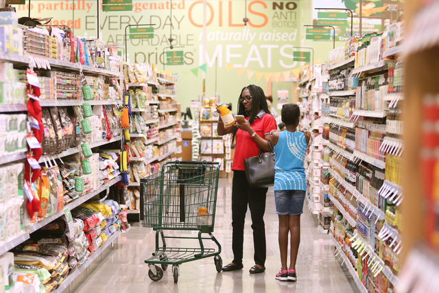 Chimezie Okwuosa, left, shops with her daughter Crystal on the opening day of Natural Grocers at 6305 Simmons St. in North Las Vegas on Tuesday, Aug. 9, 2016. The Colorado-based grocery chain also ...