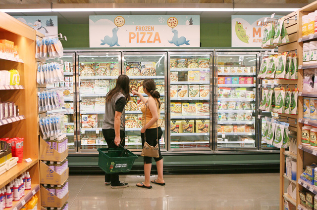 Jesse Wade, left, and Ashley Torres look at frozen pizzas on the opening day of Natural Grocers at 6305 Simmons St. in North Las Vegas on Tuesday, Aug. 9, 2016. The Colorado-based grocery chain al ...