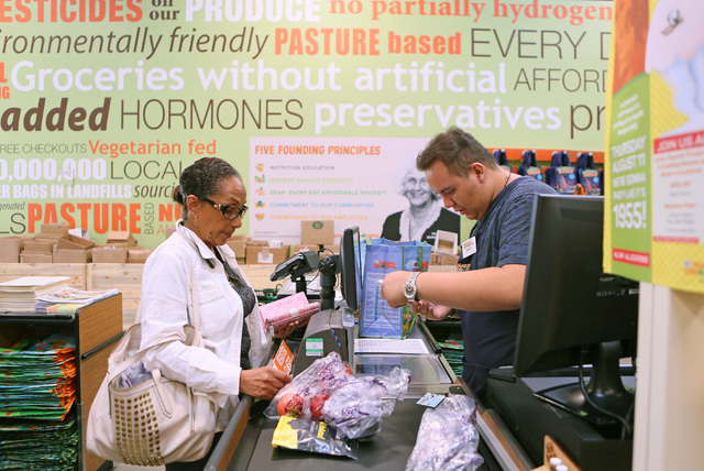 Cashier Mikey Covarrubias, right, checks out Ofelia Hinds-Marshall's groceries on the opening day of Natural Grocers at 6305 Simmons St. in North Las Vegas on Tuesday, Aug. 9, 2016. The Colorado-b ...