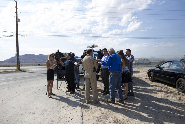 Scott Poteet, Draken International's director of business development for U.S. Air Force Programs, speaks to the media at the intersection of North Las Vegas Boulevard and North Hollywood B ...