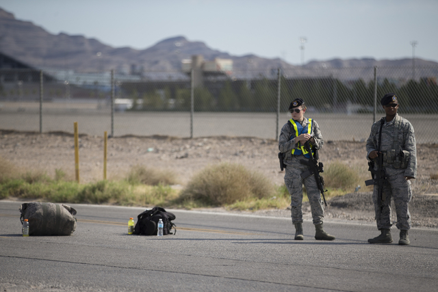 Nellis Air Force Base military police block the road at the intersection of North Las Vegas Boulevard and North Hollywood Boulevard after an aircraft crash near the area on Thursday, Aug. 18, 2016 ...