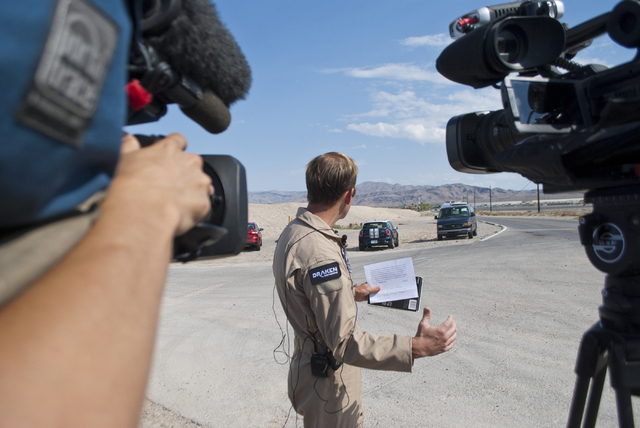 Air Force representative Scott Poteet speaks with media at Las Vegas and Hollywood Boulevards near Nellis Air Force Base on Thursday morning, Aug. 18, 2016. The briefing detailed the crash of an A ...