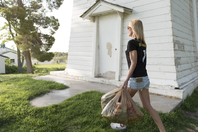 Rabbit activist Stacey Taylor carries bags of vegetables and fruit to feed to rabbits at Floyd Lamb Park at Tule Springs in Las Vegas Sunday, July 31, 2016. The park is one of several locations in ...