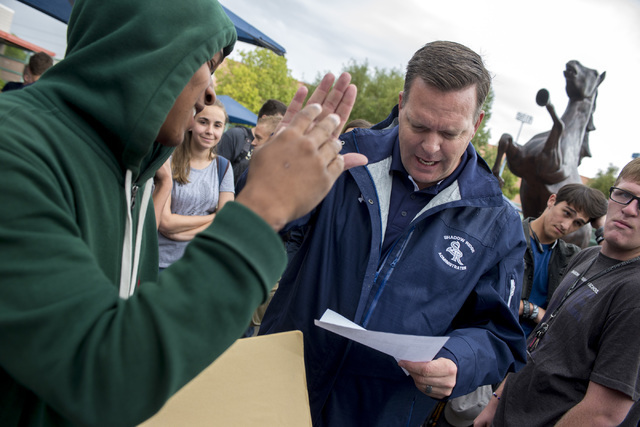 Senior Tyler Causey receives a high five from principal Travis Warnick after getting straight A's on his report card at Shadow Ridge High School in Las Vegas. Warnick was named a finalist of Varsi ...