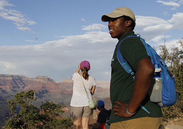 Grand Canyon National Park intern Mi-Kal White looks waits for visitors to approach him for assistance on July 26, 2016. (Beatriz Costa-Lima/The Associated Press)
