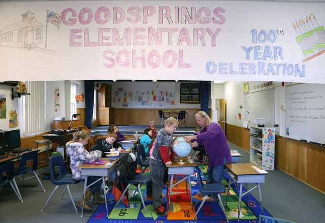 Nicholas Cruz, center, looks at a globe with his teacher Erika Samuel during class at Goodsprings Elementary School Monday, Oct. 28, 2013, in Goodsprings, Nev. The historic two-room elementary sch ...