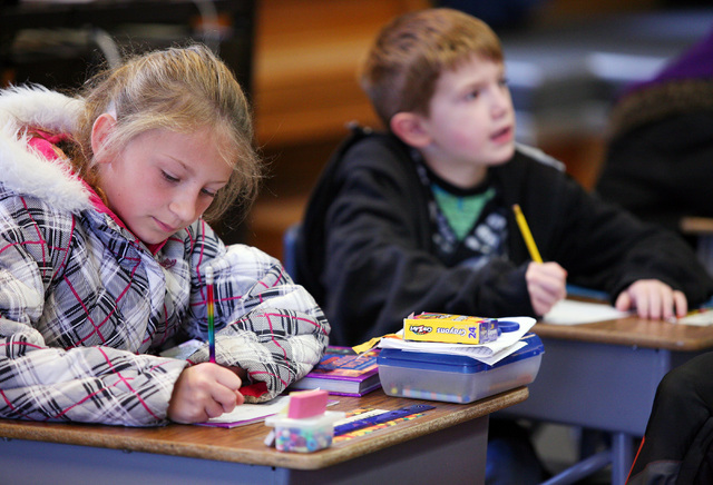 Jamey Harman (CQ), left, and Daniel DeMeglio work in class at Goodsprings Elementary School Monday, Oct. 28, 2013, in Goodsprings, Nev. The historic two-room elementary school was first used in 19 ...