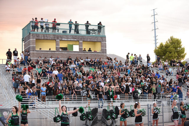 Palo Verde High School football fans watch their game against Las Vegas High School at the Palo Verde football field in Las Vegas on Friday, Aug. 26, 2016. The game was postponed during the second ...