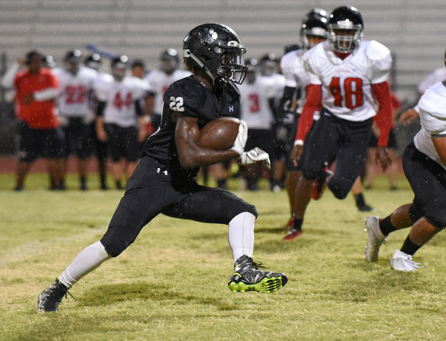 Palo Verde's Chamere Thomas (22) runs the football against Las Vegas High School's defense during their football game played at Palo Verde's football field in Las Vegas on Friday, Aug. 26, 2016. T ...