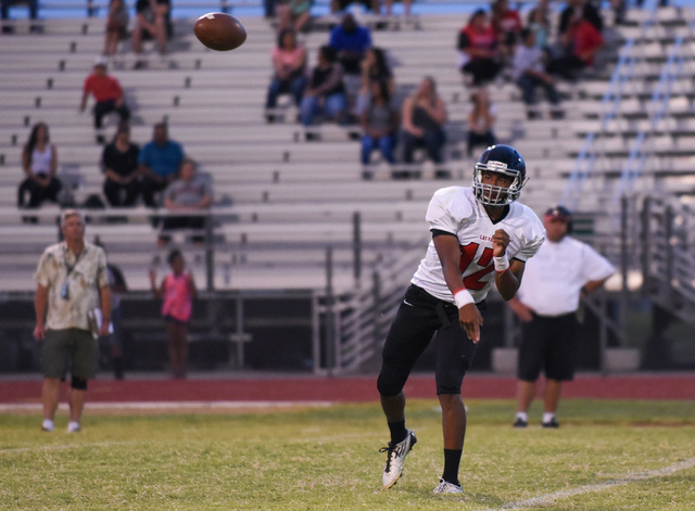 Las Vegas High School's Zach Matlock (12) throws a pass against Palo Verde's defense during their football game played at Palo Verde's football field in Las Vegas on Friday, Aug. 26, 2016. The gam ...