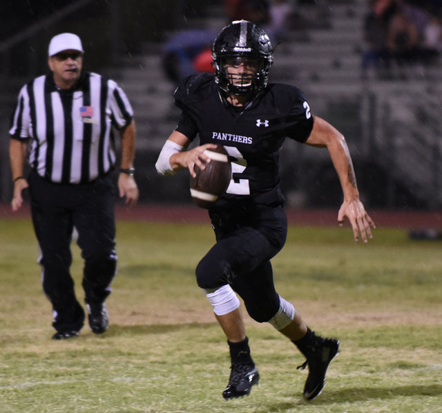 Palo Verde's Jonathan Schofield (2) runs the football against Las Vegas High School's defense during their football game playe at Palo Verde's football field in Las Vegas on Friday, Aug. 26, 2016. ...