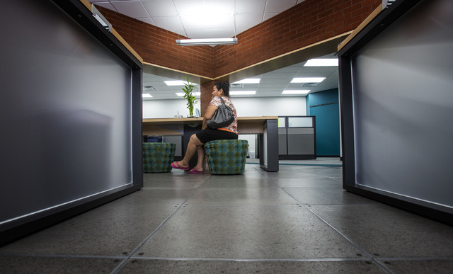 Virginia Sanchez sits in Nevada Health CO-OP walk-in center  at 3900 Meadows Lane on Wednesday, March 18, 2014. She was check on health care benefits. The deadline for the state exchange plans enr ...