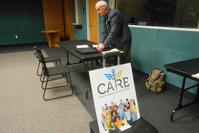 Randall Downey, exchange enrollment facilitator, sets up his computer Jan. 30 in preparation for helping people choose a health care plan at the Rainbow Library, 3150 N. Buffalo Drive. (Jan Hogan/ ...