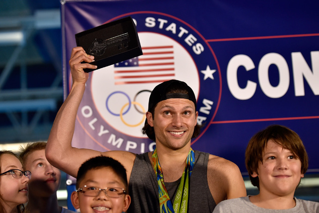 Olympic swimmer gold medalist and Las Vegas resident Cody Miller displays his ceremonial key to the Strip after a proclamation declaring Monday Cody Miller Day during a ceremony at the Desert Bree ...