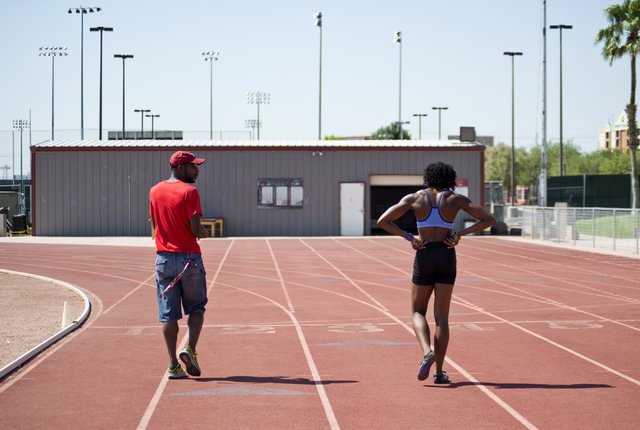 Uhunoma Osazuwa, right, trains with her coach Logan Taylor at Myron Partridge Track Stadium at UNLV in Las Vegas on Tuesday, July 26, 2016. Osazuwa will be competing in the heptathlon for Nigeria  ...