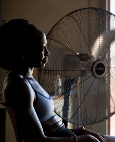 Uhunoma Osazuwa cools off during training at Myron Partridge Track Stadium at UNLV in Las Vegas on Tuesday, July 26, 2016. Osazuwa will be competing in the heptathlon for Nigeria during the 2016 S ...