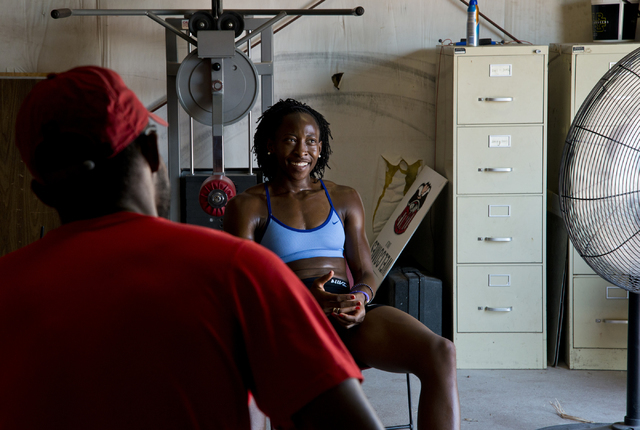 Uhunoma Osazuwa, right, and her coach Logan Taylor take a break during training at Myron Partridge Track Stadium at UNLV in Las Vegas on Tuesday, July 26, 2016. Osazuwa will be competing in the he ...