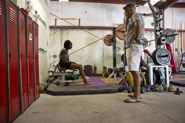 Uhunoma Osazuwa, left, and her coach Enoch Borozinski take a break during training at Myron Partridge Track Stadium at UNLV in Las Vegas on Tuesday, July 26, 2016. Osazuwa will be competing in the ...