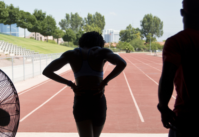 Uhunoma Osazuwa, left, and her coach Logan Taylor head onto the track during training at Myron Partridge Track Stadium at UNLV in Las Vegas on Tuesday, July 26, 2016. Osazuwa will be competing in  ...