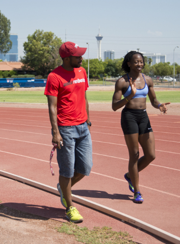 Uhunoma Osazuwa, right, and her coach Logan Taylor head onto the track during training at Myron Partridge Track Stadium at UNLV in Las Vegas on Tuesday, July 26, 2016. Osazuwa will be competing in ...