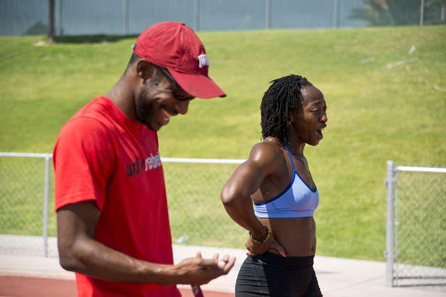 Uhunoma Osazuwa, right, and her coach Logan Taylor talk on the track during training at Myron Partridge Track Stadium at UNLV in Las Vegas on Tuesday, July 26, 2016. Osazuwa will be competing in t ...