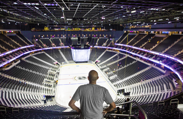 Ron Babcock, a season ticket holder for Las Vegas' NHL expansion team, takes in the view from his seats in the upper concourse at T-Mobile Arena during an open house on Monday, August 1, 2016, in  ...