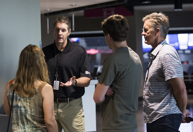 Murray Craven, left, advisor to Las Vegas NHL expansion team owner Bill Foley, interacts with guests at T-Mobile Arena during an open house on Monday, August 1, 2016, in Las Vegas. (Benjamin Hager ...