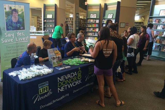 Nevada Donor Network volunteers speak with Henderson residents at a health fair Aug. 2, 2014, at the Green Valley Library. View file photo
