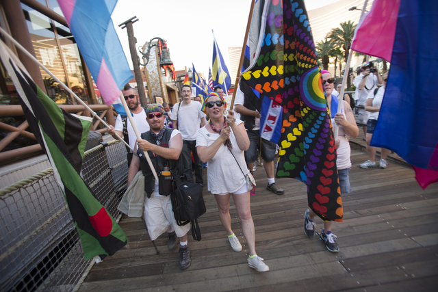 People are seen marching on the Las Vegas Strip to show their solidarity for the victims of the Pulse nightclub shooting in Orlando, Fla., in Las Vegas on Monday, June 20, 2016. Richard Brian/Las  ...