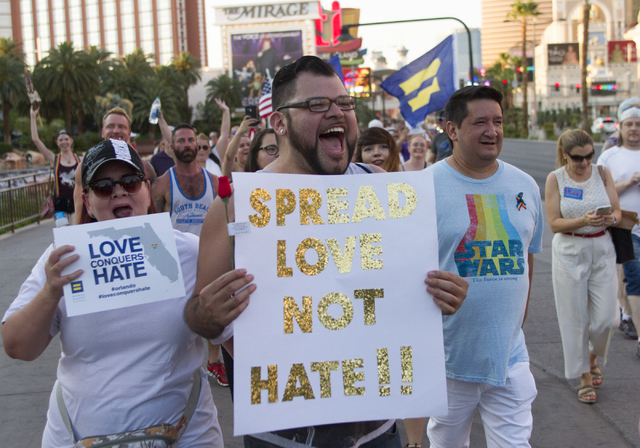 A marcher chants with other members of the community as they gather on the Las Vegas Strip to show their solidarity for the victims of the Pulse nightclub shooting in Orlando, Fla., in Las Vegas o ...