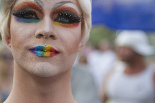 A marcher is seen as members of the community gather on the Las Vegas Strip to show their solidarity for the victims of the Pulse nightclub shooting in Orlando, Fla., in Las Vegas on Monday, June  ...