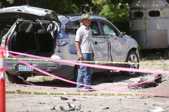 A man surveys the damage from the Wednesday night bombing that killed one person, tore a car in half and left a home uninhabitable in Panaca, Nev., on Friday, July 15, 2016. (Brett Le Blanc/Las Ve ...