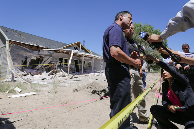 Nevada Governor Brian Sandoval, center, speaks to the media and community members with Lincoln County Sheriff Kerry Lee on Friday, July 15, 2016, at the attacked house in Panaca, Nev., about the W ...